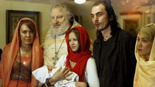 Азиза (Анфиса) и Игорь Тальков, крещение